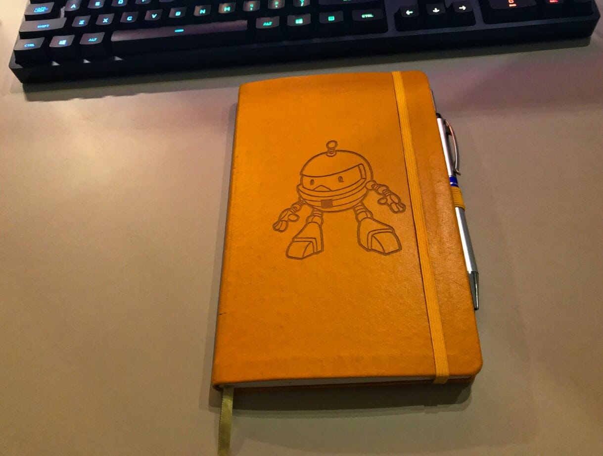 An orange paper notebook